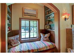 Cozy up in this precious window seat flanked by bookshelves. Or the perfect perch for your pooch to keep an eye on things!