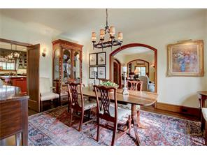 Wine and Dine your guests in this elegant dining room with arched opening to the living room.  Handsome chandelier and convenient location next to the kitchen.