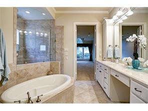 Glass Shower, Whirlpool Tub, adjoins Extra Large Closet with Built-in Drawers and Shoe Racks