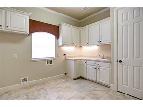 Oversized Laundry Room with Sink and Extra Storage Space