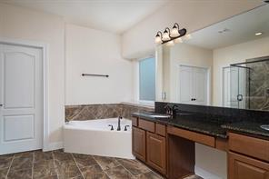 Master Bathroom includes a Cultured Marble Garden Tub, Semi-Frameless Mud Set Shower with Tile Floor, and Cultured Marble Vanity Top.