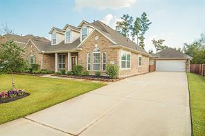 Nice long driveway with garage towards the back.  Garage includes Carriage Style Steel Raised Panel Garage Door.
