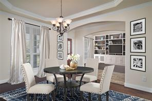 Staged photo: imagine all the great wall space for your photos in the formal dining and all the space for your furniture in the formal study.