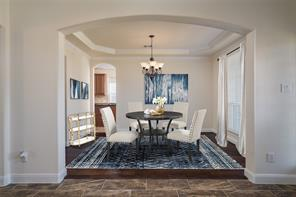 Staged photo: imagine your own furniture in this formal dinning room.