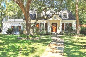 Traditional Garden Oaks at its finest. Follow the winding shaded walkway up to the inviting entry of this beautiful home with original charm and modern updates. Layout features 2 bedrooms down and cozy master retreat upstairs with shiplap walls. Just off the master is a great sitting/game room and rooftop patio for evening wine or morning coffee. This large corner lot has huge mature trees and lush landscaping. Enjoy the back patio, fire pit, and sand play area. Walk to restaurants and shopping.