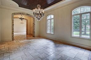 The formal dining room has a beautiful coffered wood planked ceiling- 19x13