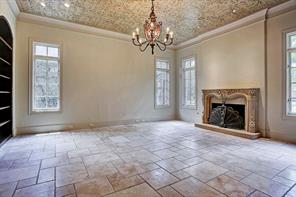 Formal Living Room - featuring a fireplace with decorative stone hearth and mantle- 19x16