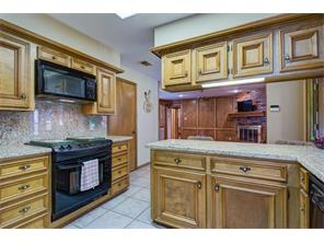 This is kitchen #1 but both kitchens feature electric ranges and granite counter tops.