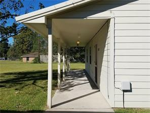 Sidewalk access from the covered carport makes the house easily accessible from the main structure.