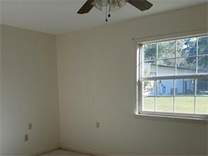 This is the bedroom which is just off the living space. Again, there s natural light and a ceiling fan!
