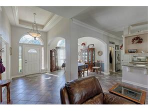 Tall ceilings with crown molding. Beautiful arched entry to the Dining room.
