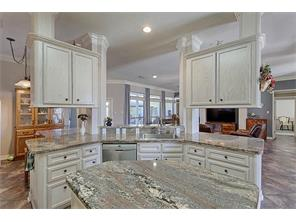 Beautiful granite countertops.  spacious kitchen with large island.