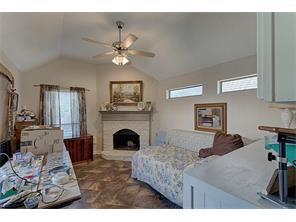 Extra room with a fireplace and sliding door leading outside to the pool.  Can be used as a  hobby   room.