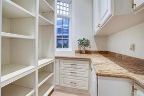 Walk-in Mud room with fabulous storage for your staples located off kitchen.