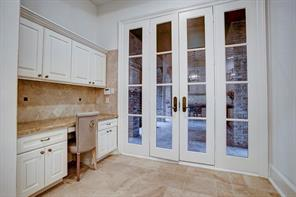 Perfect work station for laptop, etc and French doors to covered loggia.