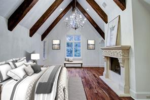 Another view of the master with crystal chandelier and fabulous treetop views.
