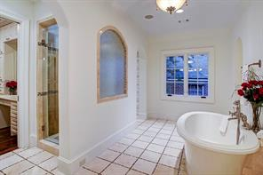 The master bath has marble floor with mosaic tile.