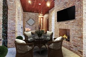 Another view showing access to to the private guest house. Please note the wood ceiling and arched brick detail.