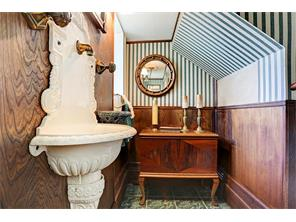 POWDER ROOM ON 1ST FLOOR OF HOUSE - down a short flight of stairs off the foyer, tile flooring