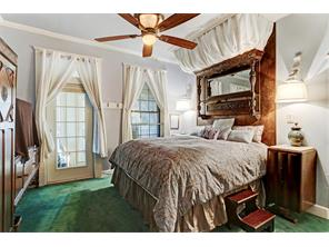 MASTER BEDROOM ON 2ND FLOOR OF HOUSE - access to one of several balconies, ceiling fan with light