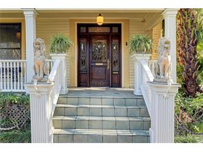 CLOSEUP VIEW OF STEPS LEADING TO LARGE FRONT  ENTRY PORCH - handsome wood door with ornate brass hardware - leaded glass insert, sidelights and transom