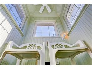 VIEW LOOKING UP INTO THE CUPOLA/LOOKOUT ON THE 4TH LEVEL OF THE ANNEX - accessed through a doorway in the den, leading to ladders to climb to get to the amazing views from this charming feature - ceiling fan, casement windows