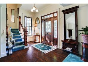GRACIOUS FOYER WELCOMES YOU TO 1415 INDIANA - wonderful architectural details include the handsome wood newel post, with secret compartment, at the base of the stairway - wood flooring, decorative light fixture