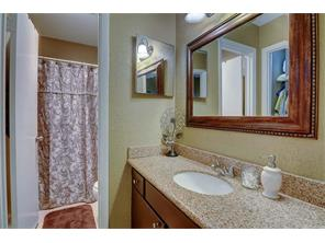 Granite and framed mirror in the master bath make it the perfect place to get dressed in the morning!