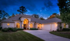 Bentwater: Beautiful Stoneleigh custom built home with builder s piers is on the #13 Weiskopf golf course 1/2 block from Lake Conroe! This home offers so many special features you don t want to miss seeing this one!