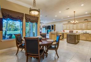 What a delightful breakfast dining area connected to the kitchen and open also to the family room.  All rooms are spacious and this home can host a large group for entertaining. Look up at another quality ceiling light fixture.