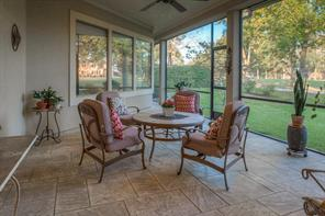 Have your evening meal in this lovely peaceful screened in porch with it s patterned concrete floor and overhead lighted ceiling fan.  What a nice place to entertain and also a nice place for your pet to feel a little more freedom.