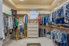 There are 2 master bedroom closets and this larger one should please anyone. There are 2 more built in shelving on each side of entry door - not  shown in this picture. Notice even the port hole window has plantation shutters.
