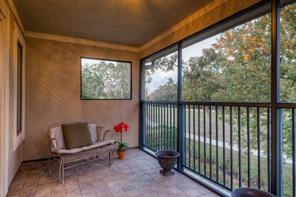 A charming quiet little screened in balcony is off the large 4th bedrm which can be a game room.  The porch is tiled with a great view of the golf course. Notice the window in the wall so you can see further down the fairway.