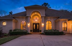 Your evening guests will be greeted by great curb appeal, arched windows with stucco surrounds and generous room for guests to park.  You will see the edge of the side entry door into the three car garage on the right.