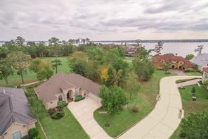 Aerial view of this lovely golf course home in The Estates of Bentwater shows how close the home is to the peaceful waters of Lake Conroe.  The National Forest is also on the lake just a little north of Bentwater.