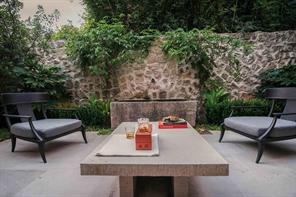 A serene courtyard sits outside the library on the east side and has a lush yet quiet garden with a tranquility fountain made from a vintage limestone water trough from the South of France.