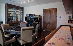 A 500+ square foot Game and Media Room connects the two wings and opens up to a limestone terrace overlooking the pool and backyard.