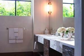 Downstairs Master bath has heated tile floors, floating marble vanity with under mount double sinks and allows for wheelchair accessibility.
