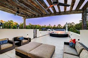 Well lit Roof top terrace with reclaimed oak trellis provides stunning tree top and city views. Fire pit allows for warmth on chilly nights. Wet bar with refrigerator under cover.