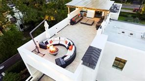 Roof top Terrace with Three Inch Ply TPO Roof. Easy location of A/C s and Tankless Hot Water Heater Systems.