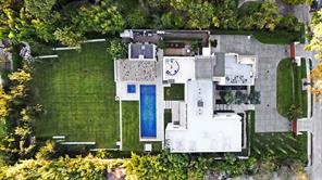 Three Inch Ply TPO Roof. A/V Savant System with complete controls, 1 Gig Ready Internet, 2-Surround sound Theater systems, 23 security cameras with prewire for more. Aerial View of your new home in Bayou Woods, Close In Memorial.