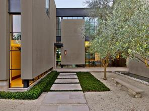 Within dual walls made of greenery, tumbled Texas limestone, and crushed granite you will find an entry courtyard with a reflecting pool filled with koi and water lilies. Lavender and olive tree gardens frame the entry.