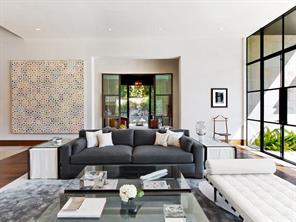 The living room surveys the backyard and its limestone edged pool.