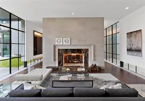 Limestone blocks surround the Living Room s double sided carved marble fireplace. The space is created to provide easy circulation on either side to the dining area.