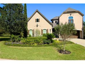 Perfectly manicured and conveniently located in the gated country club community of Bentwater on Lake Conroe.  Your own gated vestibule provides access to the home s front door, the casita and both garages.
