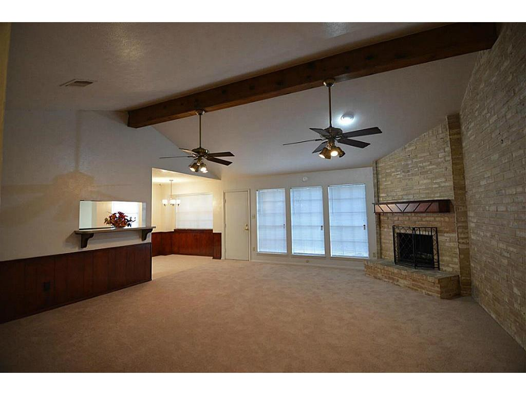 Vaulted Ceiling Family Room With New Carpet Corner Fireplace Dual Fans