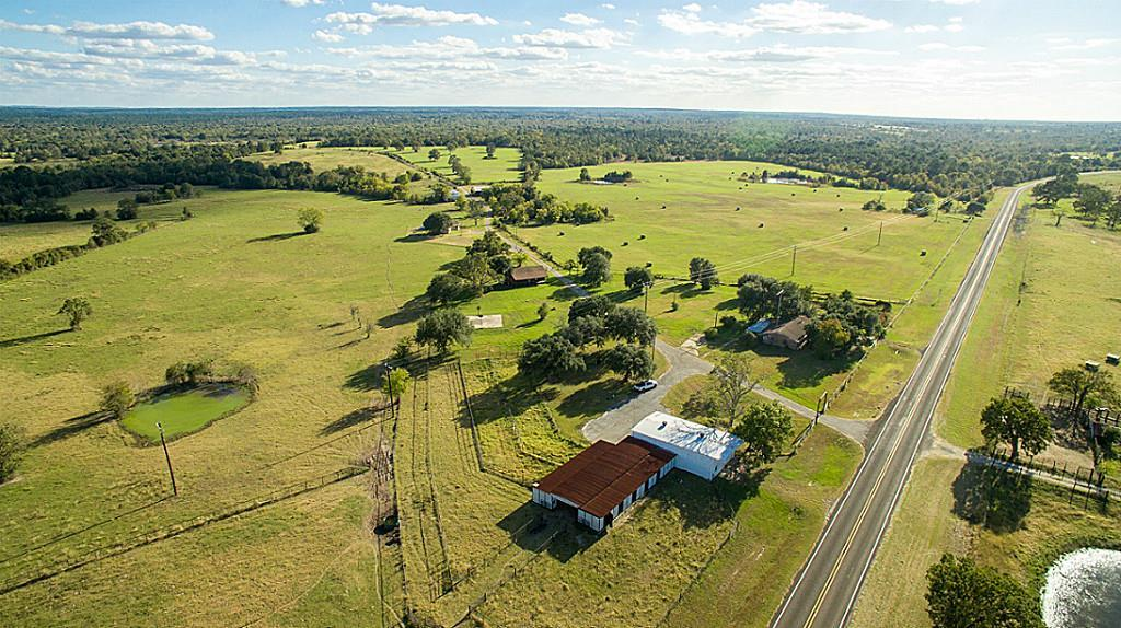 This ranch style property features unique hilltop vistas overlooking highly improved rolling pastures ponds! Mossy oaks are scattered across the property, fenced & cross-fenced, with 9 stock tanks.At front of property you'll find great access with black top frontage & pipe fencing. There's a brick home, 10 stall horse barn, 2 hay barns, & equipment barn. Approx 100 acres are wooded, offering great recreational deer & hog hunting. 30 min.to Huntsville an hour to Bryan/College Station.
