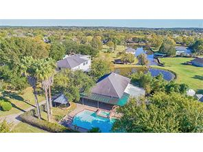 Not just a home, but a Lake Conroe oasis. With this view you can see the way the property is layed out over the 2.09 acres.   Check out the boat slip with lift  for quick access to Lake Conroe. & you even have your own pond.