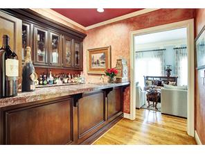 The wet bar is located between the Gentleman s study and the formal living room.  Strategically placed for entertaining - large or small