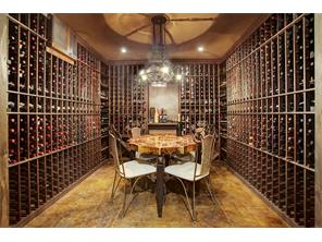 This is what a well stocked wine cellar should look like.  There could be a cask of amontillado  stored here.
